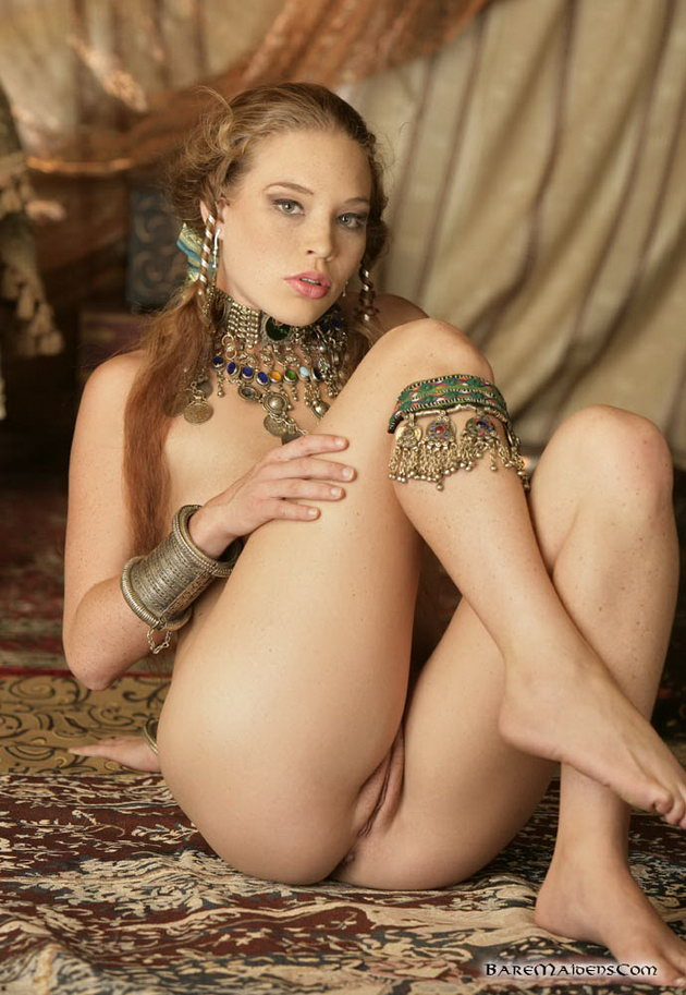 Redhead stripping and pleasureing her sweet self 2