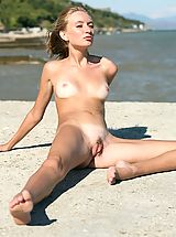 Small titted sexy blonde with tanlines posing on the beach