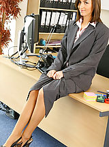 Melanies perfect figure is flattered by the sexy lingerie under her suit skirt and blouse