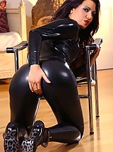Kinky brunette unzips her tight black catsuit to reveal her hot body in lemon lingerie.