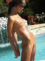 with this tight bikini her perky tits are barely covered, as she puts various objects into her vulva poolside