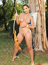 Sexy brunette slut Eve Angel poses exposed outdoors with bow