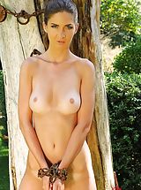 Charlotta chained to a tree nude pissing on the ground