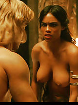 Rosario Dawson shows her incredible jugs while driving her guy in bed