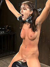 Hot, tan girl in pig tails bound and helpless on a sybian made to cum until she is breathless.