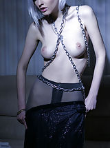 Large fun bags Top model Kira W chained her delectable creamy body as she erotically poses on   the bed.