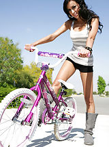 Hot chick Breanne chooses between riding a bike and riding Ryans cock.