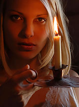 Big Breasts Busty blonde in an erotic candle-lit series.