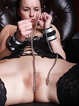 Big Breasts Alex C plays with her erect nipples and smooth muschi on the chair.