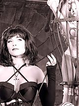 Black and White film enhances this scenario - innocent Ashley caged as a submissive slave who succumbs to delicious Dominatrix Summer Knight, cruel intentions? Oh yes!